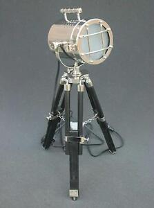 Silver spot light with black polished wooden tripod