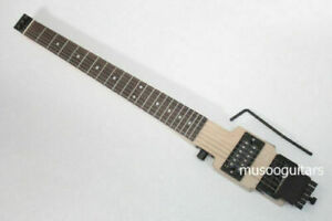 Electric travel headless guitar with tremolo