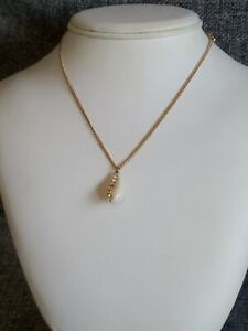 Pretty delicate gold metal chain cowrie shell sparkle detail pendant necklace