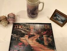 thomas kinkade book, pair of christmas ornaments, pitcher, and framed print