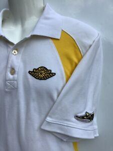 Nike Jordan Mens sz L large White w/ yellow trim sewn Logos Golf Polo Shirt