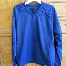 Men's golf Greg Norman V-neck blue rain gear Pullover size M brand new Nwt $75
