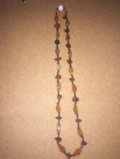 statement necklace, amber stones, round neck, suitable for warm tones.