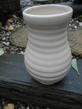 stunning example of a stoneware ribbed vase