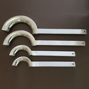 A set of 4 bell irons for  trumpet   and   trombone