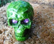 Skull Green with Purple Eyes