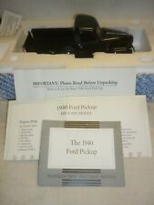 A Franklin mint model of a 1940 Ford pick up truck.  Boxed