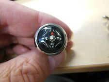 Pair of cufflinks with compass
