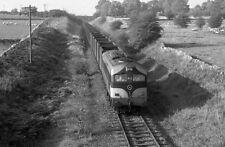 PHOTO  1985 CIE'S 001 CLASS DIESEL LOCO TRAIN 013 NEAR BALLYGLUNIN HAULED BY A C