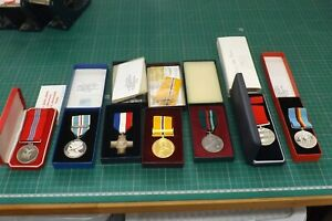 SEVEN FULL SIZE CASED MEDALS NAMED TO 3502148 SGT CROWLEY T.ON 1946-1956 RAF