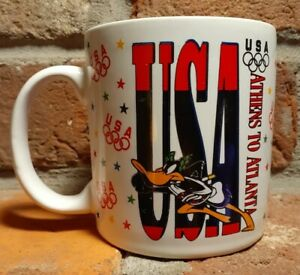 Warner Bros 1996 Olympic USA Athens To Atlanta Coffee Mug Cup Sakura Daffy Duck