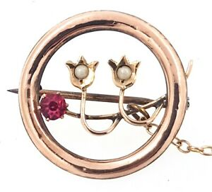 9k rose gold Antique Brooch/Pin set with one red synthetic stone and two pearls