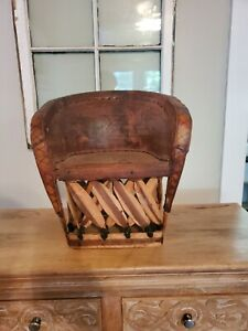 Mexican Equipale Leather Chair with etchings of man hunting- Brick Color