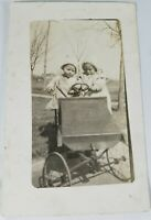 Vintage Real Photo Post Card A Pair of Toddlers in an Early Toy Car 1900's? AZO