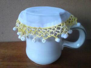 1 Hand-Made Milk Jug Cover. Random Yellow With White Beads.