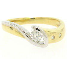 Abstract 18k Two Tone Gold 0.19ctw Burnish & Channel Set Round Diamond Band Ring