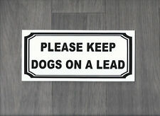 Please keep dogs on a lead.  Plastic Indoor / Outdoor Sign.  (DS-11)