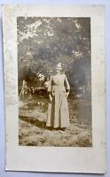 Vintage RPPC Woman In Prairie Country Dress Outside Real Photo Picture Postcard