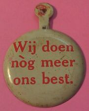 1960'S AVIS PINBACK ~ DUTCH ~ WE TRY HARDER ~ IN ANY LANGUAGE ~FEATURES PLYMOUTH