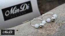 Earrings, pair of handmade hoop earrings with sterling silver & white jade.