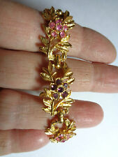 GOLD TONE LEAF BRACLET WITH PINK AND PURPLE FLOWERS