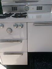 Vintage 50's 60's Monarch white gas stove with storage, broiler and an oven
