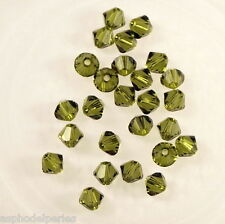 50 perles  toupies en cristal de Swarovski  5328 Olivine 4 mm