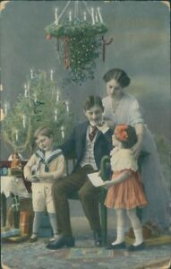 Christmas Greetings 1915 Tree Candles Domestic Scene Parents Children