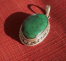 Elegant Oval Tibetan Turquoise Pendant w/ Carved 925 Sterling Silver Setting