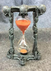 skeleton  hourglass w/ orange sand