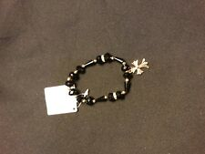 Onyx and crystal bracelet with gold cross accent