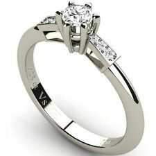 Solitaire with Accents Good Cut Round Fine Diamond Rings