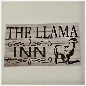 The Llama Inn Sign