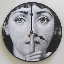 Wall clock. Fornasetti clock with iconic digital image of a woman's face.
