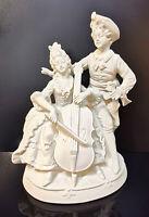 9924015-ds Porzellan Figur Rokoko-Paar mit Cello weiß  Wagner&Apel H21cm