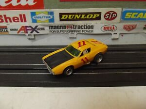 AURORA  AFX YELLOW #11 DODGE CHARGER STOCK With MAGNATRACTION CHASSIS