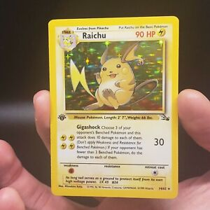 1999 Pokemon 1st Edition Fossil Set Holo Raichu 14/64 EX/NM