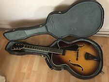 Semi-hollow jazz archtop guitar by luthier Marioni