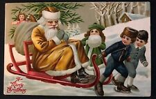 Brown Robe Santa Claus on Sled with Toys~Children~1911 Christmas~ Postcard-k602