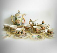 Capodimonte tea set with dragon handles and with lovers scenes