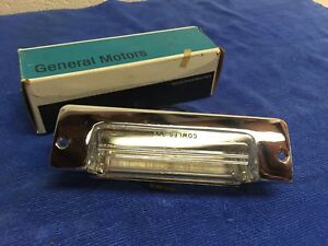 "GM 898309 1957 CHEVROLET BEL AIR LICENSE PLATE LIGHT ""NOS"""