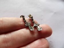 PAIR OF SILVER TONE CRYSTAL SET ARTICULATED DROP PIERCED EARRINGS    AX16