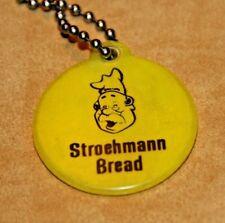 """STROEHMANN BREAD YELLOW KEY CHAIN ADVERTISEMENT.... 1 5/8"""" ROUND"""