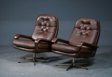 Danish swivel chair in brown leather