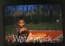 1950s red border Kodachrome Photo slide Young boy eating a Hamburger Trampoline