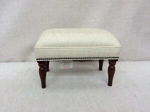 Footstool upholstered in a Laura Ashley fabric Edwin pale natural
