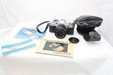 Canon AV-1 w/ 50mm FD 1.8 lens cap strap cover