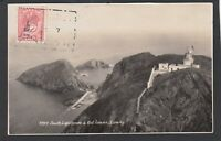 Postcard Lundy Island nr Devon the South Lighthouse and Rat puffin stamp 1938 RP