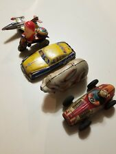 Antique tin wind up toys