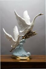 PORCELAIN AND BRONZE DOUBLE SWANS IN FLIGHT FIGURINE